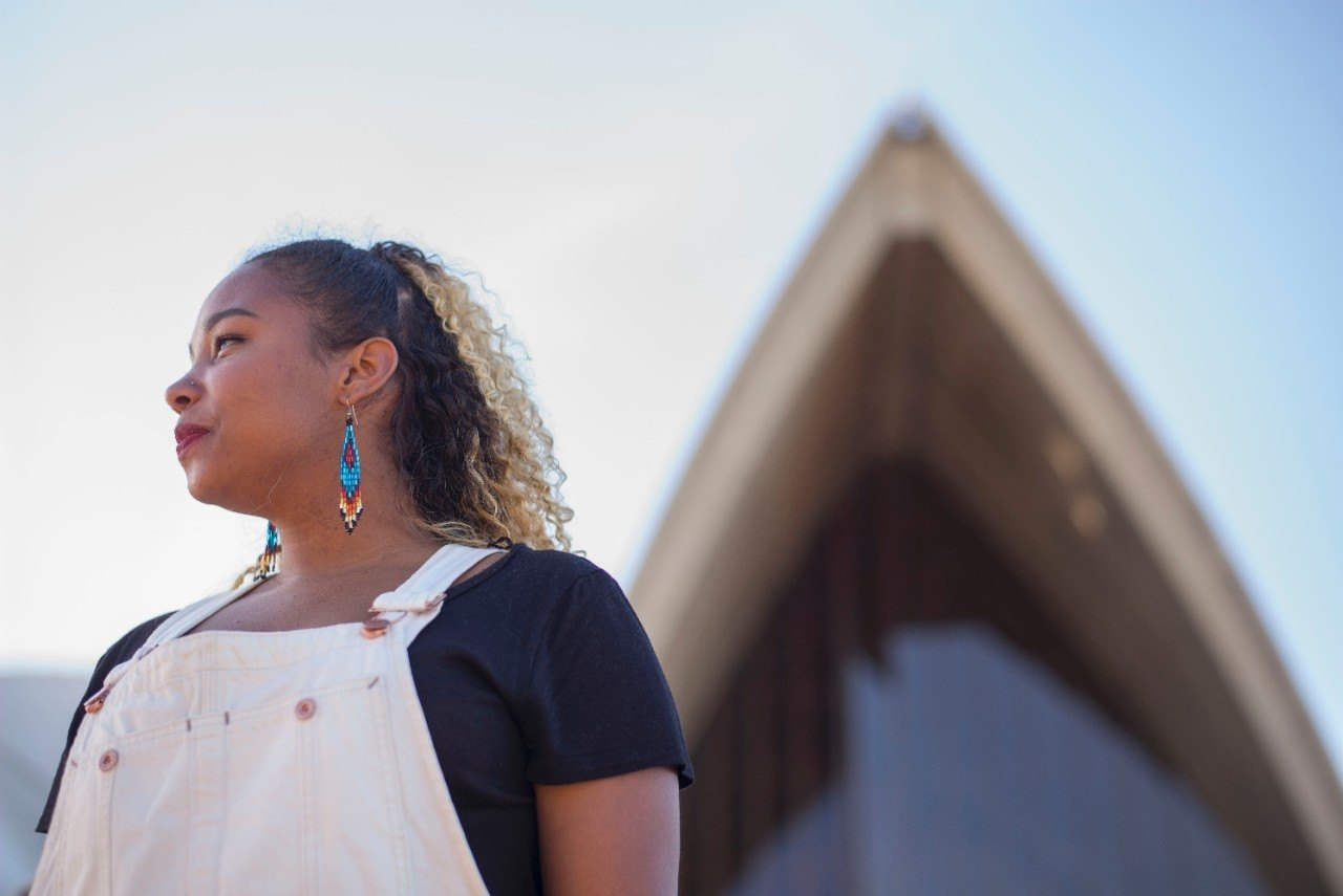 Taylor stands in front of the Sydney Opera House