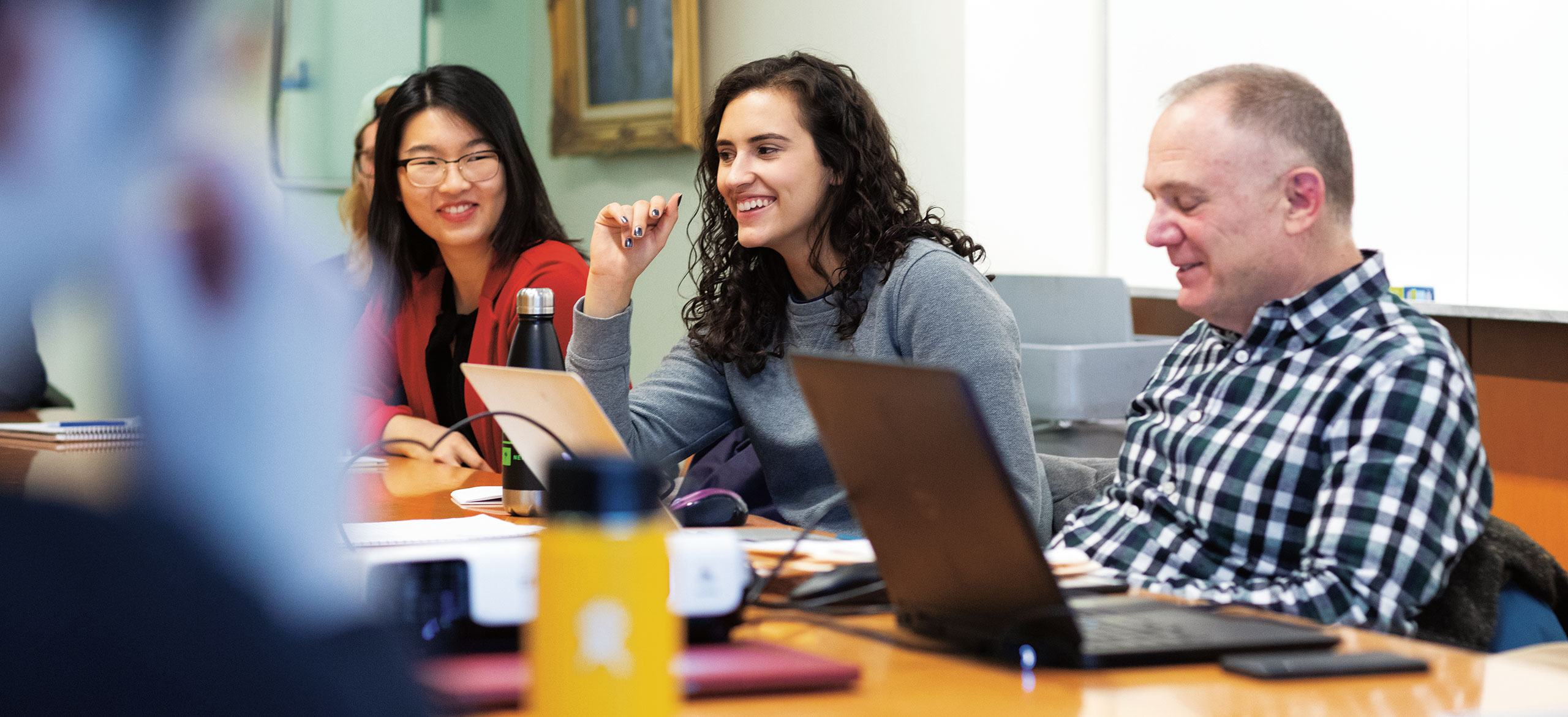 Female students and professor in class