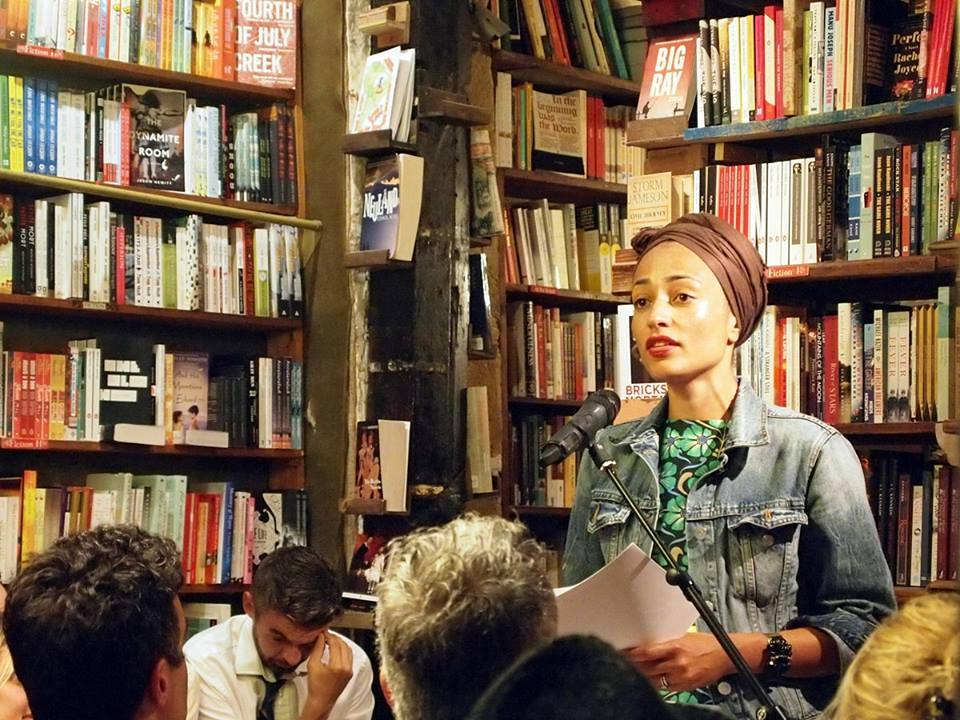 Zadie Smith speaking in front of group.