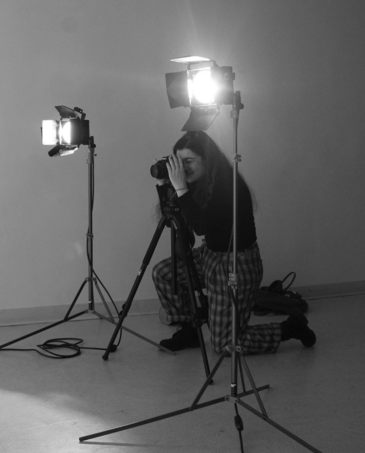 A female student taking a photograph.