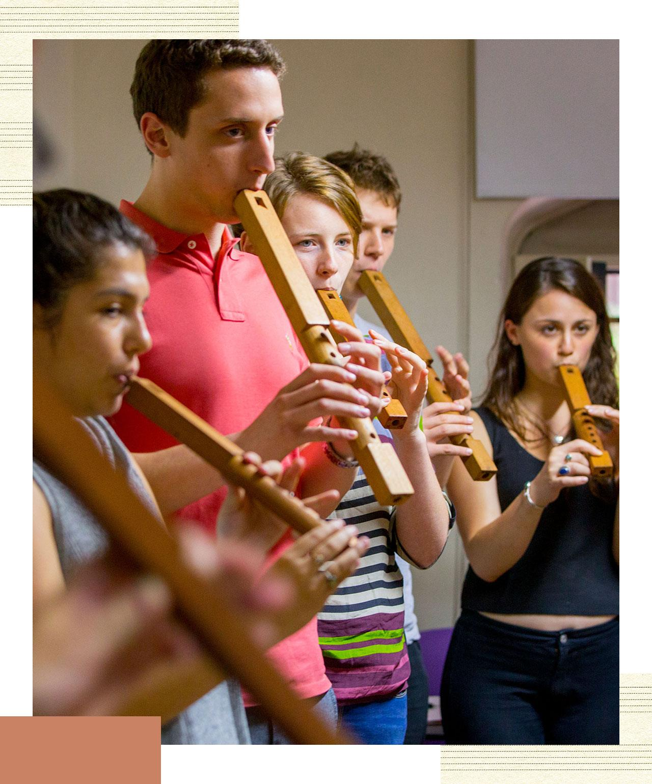 A group of students playing wind instruments.