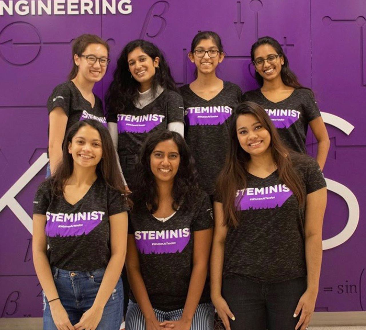 A group of students wearing shirts that represent the STEMinist club.