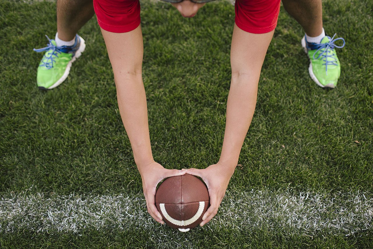 athlete holding a football