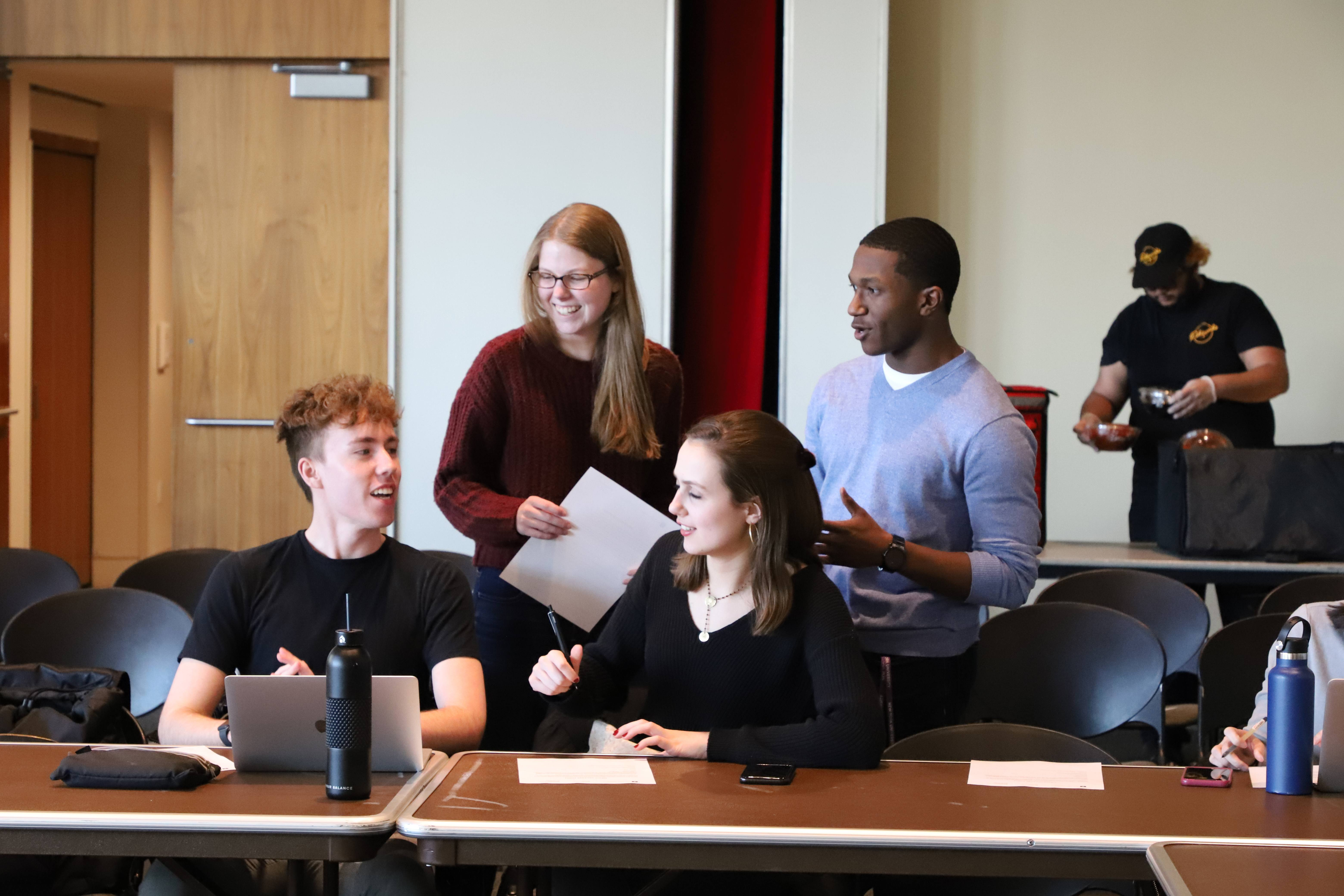 Four students working together at a table.