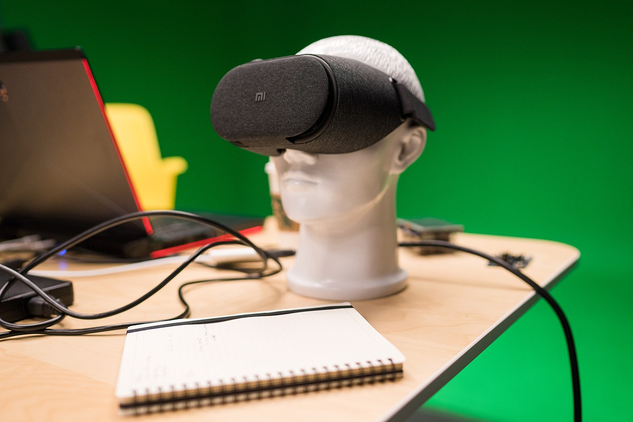 A VR set sitting on a model head