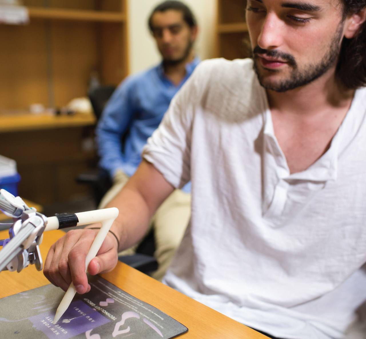 A student working with a robotic prototype.
