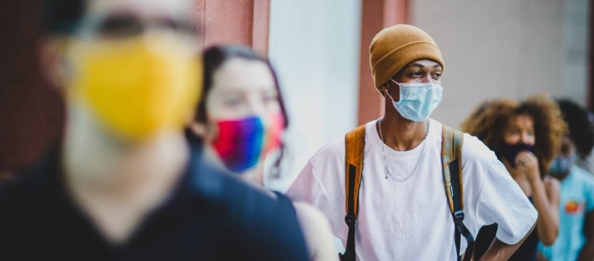 NYU's resilient students wearing masks.