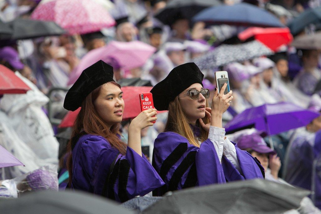 NYU grads recording Commencement for social media.